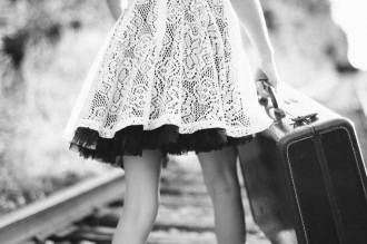 Girl-with-a-suitcase-on-the-train-tracks